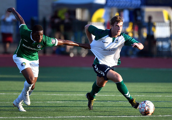 6/30/2018 Mike Orazzi | Staff Hartford City FC's Andrew Geres (11) and the New York Cosmos' Zaire Bartley (17) during Saturday evening's match at CCSU in New Britain.