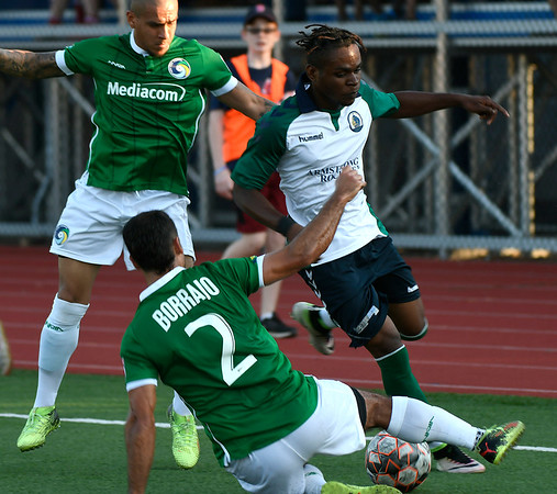 6/30/2018 Mike Orazzi | Staff Hartford City FC's Xahne Reid (2) and the New York Cosmos' Jonathan Borrajo (2) during Saturday evening's match at CCSU in New Britain.