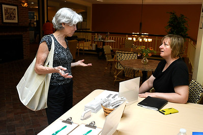 6/30/2018 Mike Orazzi | Staff Nancy Berns talks with Abundant Heath Massage Therapy & Wellness' Kristina Mozzicato during the Wise & Well Health Fair held at Atria in Farmington Saturday.