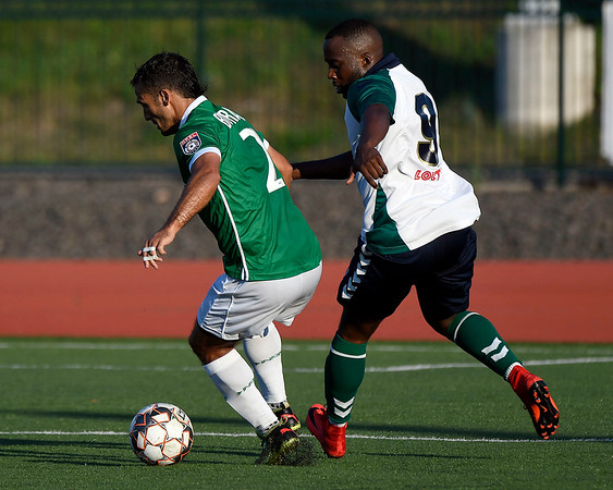 6/30/2018 Mike Orazzi | Staff Hartford City FC's Ryan Taylor (9) and the New York Cosmos' Jonathan Borrajo (2) during Saturday evening's match at CCSU in New Britain.