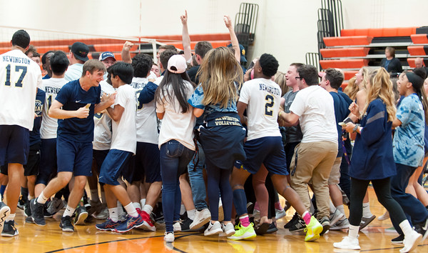 06/07/18 Wesley Bunnell | Staff Newington volleyball defeated Joel Barlow on Thursday night at Shelton High School to claim the Class M State Championship. Fans mob the floor surrounding the players immediately following their victory.
