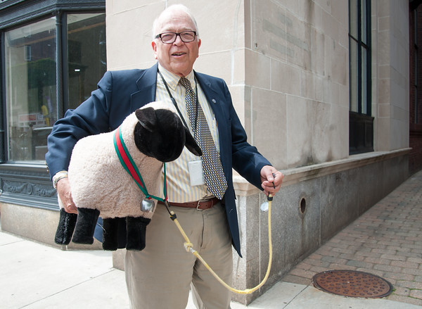 06/07/18 Wesley Bunnell | Staff The Republican Caucus held a conference on Thursday afternoon outside of city hall to express their frustration over the lack of an adopted budget for the upcoming fiscal year. Alderman Don Naples walks to the conference with a stuffed sheep which he brought as a metaphor of how he perceives the Democratic Caucus.