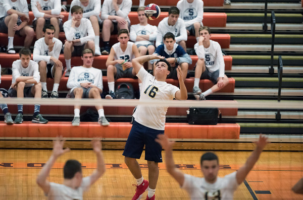 06/07/18 Wesley Bunnell | Staff Newington volleyball defeated Joel Barlow on Thursday night at Shelton High School to claim the Class M State Championship. Julian Ortiz (16) serves.