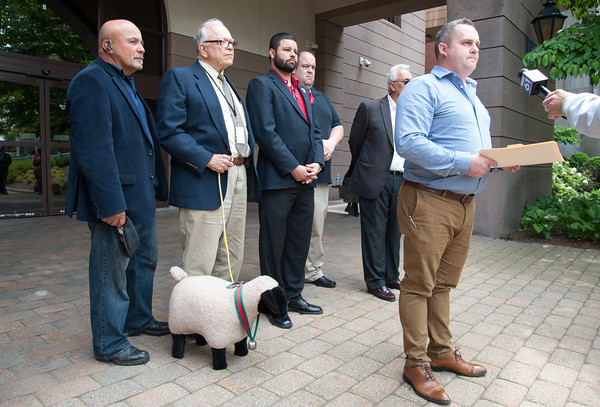 06/07/18 Wesley Bunnell | Staff The Republican Caucus held a conference on Thursday afternoon outside of city hall to express their frustration over the lack of an adopted budget for the upcoming fiscal year. Alderman Robert Smedley speaks to the media. Alderman Robert Smedley speaks to the media as Alderman Don Naples stands near a stuffed sheep which he brought as a metaphor of how he perceives the Democratic Caucus.