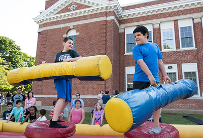 06/08/18  Wesley Bunnell | Staff  Vance Elementary School held an end of the year celebration on Friday night for students and parents.  Fifth graders Nathaniel Elmani, L, and Edwin Serrano take shots trying to knock each other over.