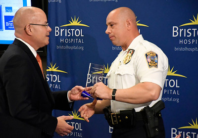 6/8/2018 Mike Orazzi | Staff Kurt A. Barwis, FACHE President and Chief Executive Officer of Bristol Hospital presents the Bristol Police Department with a Hospital Championship award, accepting is police chief Brian Gould.