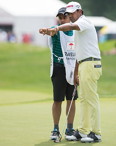 06/24/18  Wesley Bunnell | Staff  The final day of The Travelers Championship at TPC River Highlands in Cromwell on Sunday June 24. Anirban Lahiri points out the breaks on the green with his caddie. Lahiri finished T9 with a -12 on the tournament.