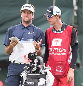 06/24/18  Wesley Bunnell | Staff  The final day of The Travelers Championship at TPC River Highlands in Cromwell on Sunday June 24. Tournament Champion Bubba Watson speaks with his caddie on the 18th tee would win with a -17.