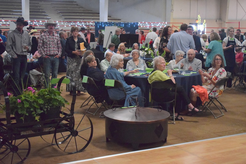Guests at the Sterling Community Fund Gala listen to a presentation by committee members June 1, 2019.
