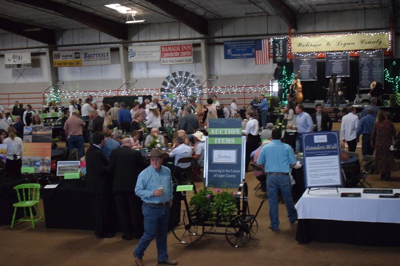 Guests gather inside the indoor arena at the Logan County Fairgrounds for the Sterling Community Fund Gala June 1, 2019.