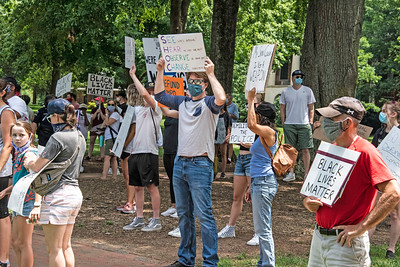 A wide variety of protest signs could be seen as folks gathered at a social distance in advance of the Community Solidarity March (#BlackLivesMatter) in Davidson. [Bill Giduz photo]