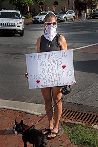 One the early morning protestors shared the words of Dr. Martin Luther King Jr. on her poster. [Bill Giduz photo]