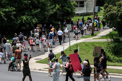 A crowd estimated at between 700-800 people marched from Main Street to the Ada Jenkins Center. The front of the group reached Ada while there were still people coming down the hill of Depot Street. [Bill Giduz photo]