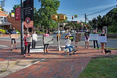 A group of early protestors stood at Main St. and Concord Road to share their messages with drivers and walkers who passed by the corner. [Bill Giduz photo]