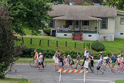 As the marchers walked up Sloan Street, they passed by the house once owned by Ada Jenkins. The teacher was so beloved that the Davidson Colored School was renamed to honor her in 1955. [Bill Giduz photo]