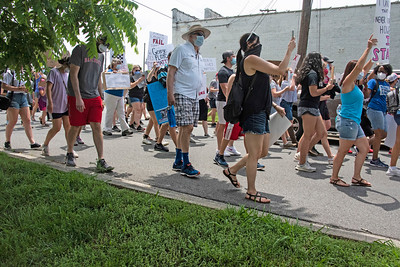 Marchers filled Depot Street as they headed to the Ada Jenkins Center during the Community Solidarity March. [Bill Giduz photo]