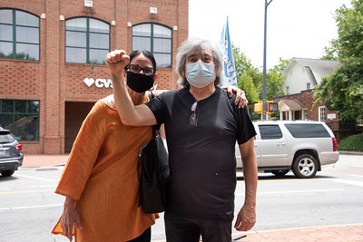 Luis Pena strikes a power-masking post for Magdalena Maiz-Pena on Main Street. (Bill Giduz photo)