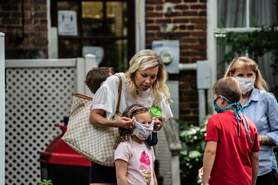 At the stroke of 5 p.m., these moms stopped to mask up their children. (Bill Giduz photo)