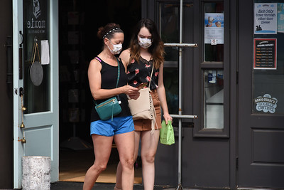 A compliant duo exits Moxie Merchantile with masks in place. (Bill Giduz photo)