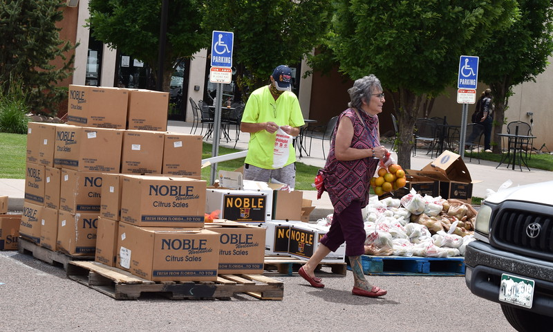 Volunteers hand out thousands of pounds of food during a mass food giveaway hosted by the Vineyard Church and The Pantry of Fremont on Friday. Carie Canterbury/Daily Record 5-29-20