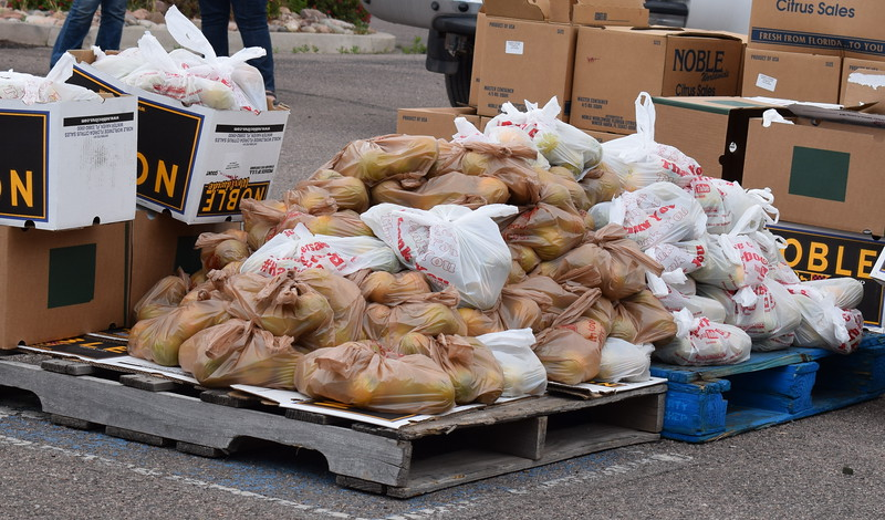 Thousands of pounds of food were distributed during a mass food giveaway hosted by the Vineyard Church and The Pantry of Fremont on Friday. Carie Canterbury/Daily Record 5-29-20