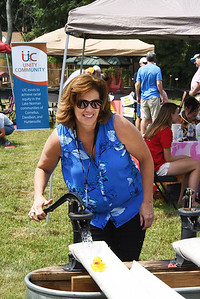 State Senator Natasha Marcus, a former volunteer and staff member at the Ada Jenkins Center, volunteered to supervise the duck races.