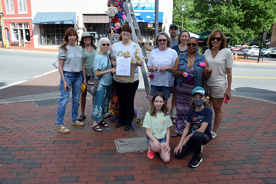 The Hearts on Fiber knitting group began knitting flowers to honor their late friend Sue Younts. Sunday morning, they gathered on Main Street near where she was killed to create a beautiful memorial to their friend.