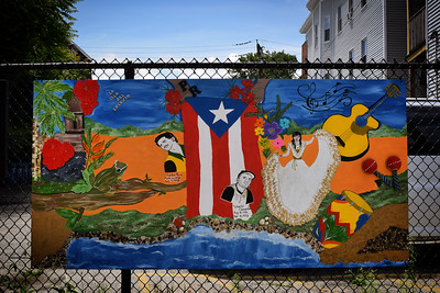 A painting unveiled Saturday on Decatur Way in Lowell -- a formerly run-down alley behind UMass Lowell's University Crossing building, which is now home to murals and art from community groups around Lowell. This painting, by Enna Pagan, was added to the alley along with drawings by Victor Rios and poems by Vivian Ruiz to celebrate Puerto Rican culture.  SUN/Robert Mills