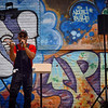 Lowell-based hip hop artist Dilly performs a new song Saturday on Decatur Way in Lowell, where a mural, poems, and drawings were unveiled to celebrate Puerto Rican culture in Lowell. The once-run down alley now hosts artwork from community groups around Lowell. SUN/Robert Mills