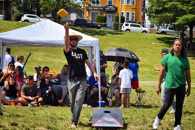 Brad Buitenhuys, of the Lowell Litter Krewe team, tosses a bag of cornhole during a Toss Against Hate cornhole tournament on Lowell's South Common Sunday. The event was organized by the EAST Movement, which teamed up with the Lowell Litter Krewe -- led by Buitenhuys -- to clean the South Common in the days before the fundraiser and community event. SUN/Robert Mills SUN/Robert Mills