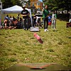 Jimmy Chan of Lowell -- part of the Seasia team -- comes oh so close to scoring in a game of cornhole that was part of the Toss Against Hate cornhole tournament organized by the EAST Movement -- Every Asian American Ally Stands Together -- on Lowell's South Common Sunday. SUN/Robert Mills