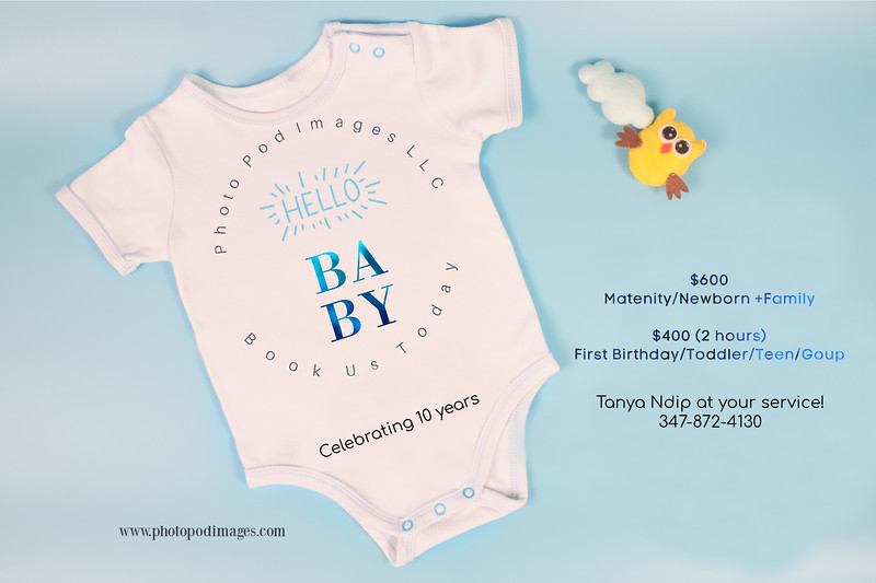 Flay lay of Blue Baby Bodysuit / Baby Jumpsuit for baby boy isolated on blue colored background, Baby shower, It's boy concept