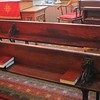 Wooden desks along the pews at the Schoolhouse, Moriah Chapel