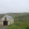 Not sure, but perchance the loo and/or a modest visitor center at Solva Beach?