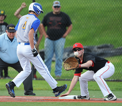 Johnsonburg's Austin Green, left, gets safely back to first base on a pickoff attempt in the top of the fourth inning of a PIAA first-round playoff game in Somerset, PA., Monday, June 4, 2018. Green avoided a tag by Conemaugh Township first baseman Ethan Leasure. Conemaugh Township went on to win 6-1.