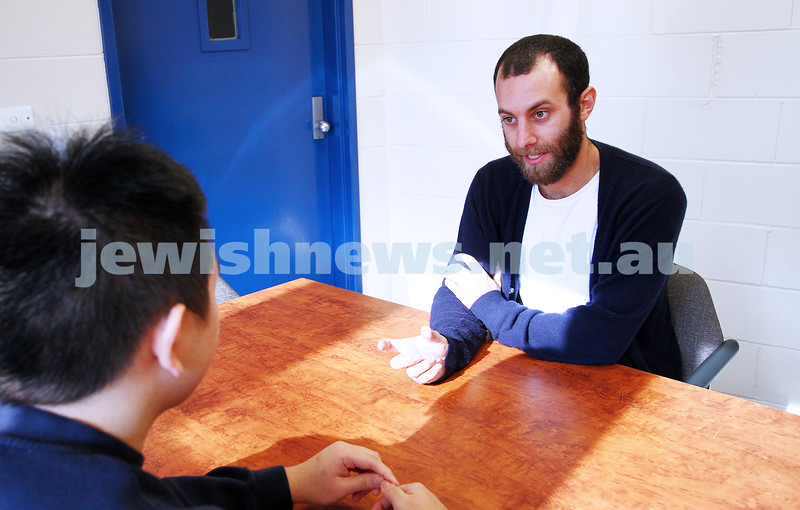 30-4-14. Parkville College. Youth Detention Centre, Melbourne. Benji Gersh, who teaches at the College, having some contact time with one of his students.  Peter Haskin