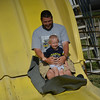 Michael Imburja holds his son Noah on the slide at the Sacred Heart Parish Picnic Saturday.