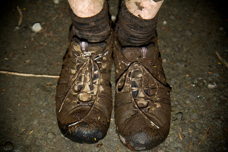 The result of stepping a foot deep into mud in total darkness.