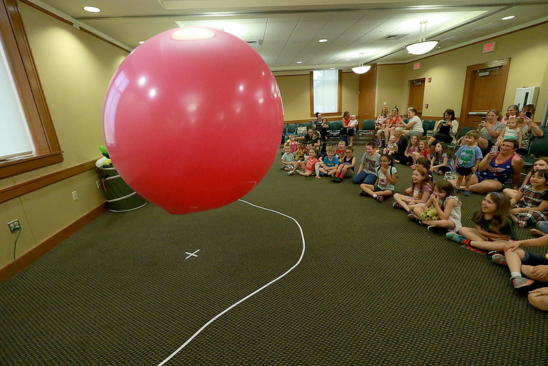 Jungle Jim performed his balloon and magic show at the Leominster Public Library on Wednesday afternoon. To end his show he put himself inside a very big balloon. You can not see him here but he is jumping inside the balloon. SENTINEL & ENTERPRISE/JOHN LOVE