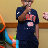 Jungle Jim performed his balloon and magic show at the Leominster Public Library on Wednesday afternoon. To end his show he put himself inside a very big balloon. Having a good laugh as he helped Jim out with his show was Javani Calderon, 7, from Leominster. SENTINEL & ENTERPRISE/JOHN LOVE