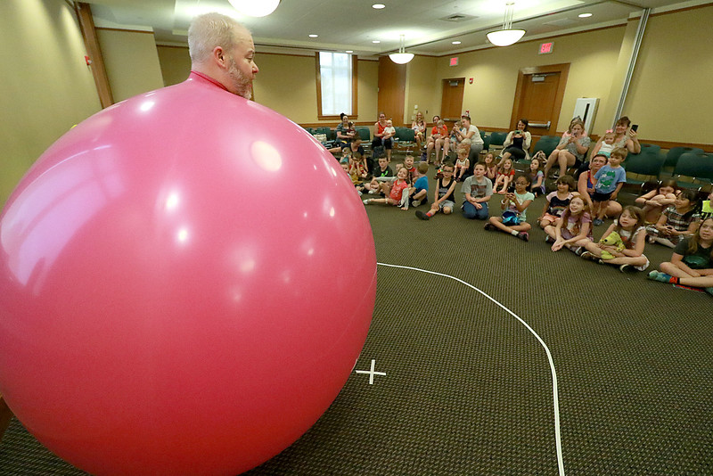 Jungle Jim performed his balloon and magic show at the Leominster Public Library on Wednesday afternoon. To end his show he put himself inside a very big balloon. SENTINEL & ENTERPRISE/JOHN LOVE