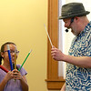 Jungle Jim performed his balloon and magic show at the Leominster Public Library on Wednesday afternoon.  Angely Santana, 9, from Leominster has a good laugh with Jim as she helps him with his show. SENTINEL & ENTERPRISE/JOHN LOVE
