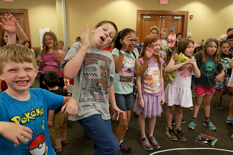 Jungle Jim performed his balloon and magic show at the Leominster Public Library on Wednesday afternoon. Kids dance around to eighty's music during the show. SENTINEL & ENTERPRISE/JOHN LOVE