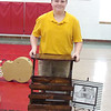 JUNIOR BETA TALENT— Oran Guardian Angel student Nathaniel Woods holds the magazine rack he built for the woodworking category of the Missouri Junior Beta Convention held March 8 and 9 in Poplar Bluff. (<i>The Mirror</i>)