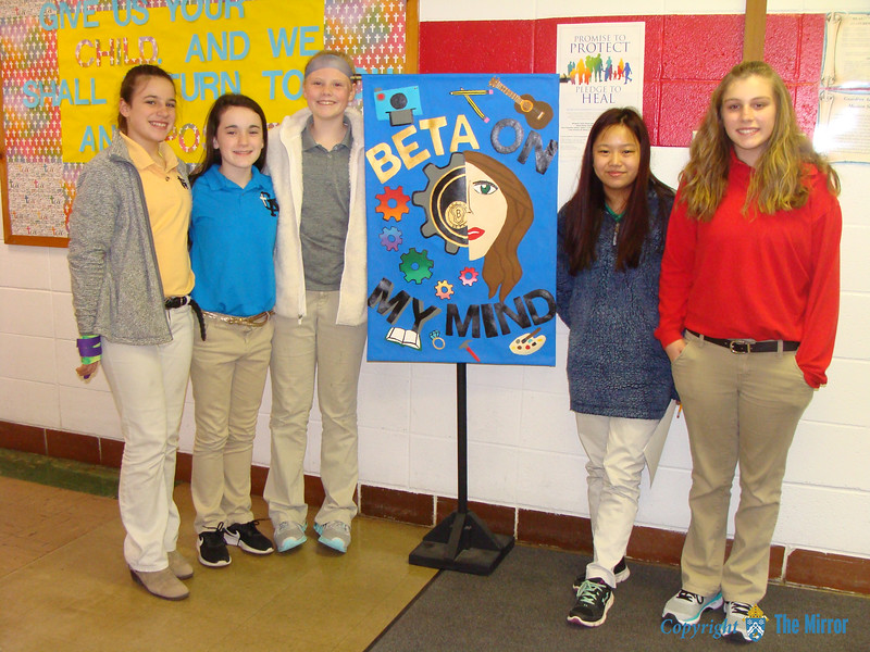 "JUNIOR BETA BANNER—""Beta on My Mind"" was the theme of the 2018 Junior Beta Convention held March 8 and 9 in Poplar Bluff, MO. Pictured are the creators of the banner for Guardian Angel School, Oran:  Dalaini Bryant, Taylor Hobbs, Haley Webb, Sophie Priggel, and Daley Siebert. (<i>The Mirror</i>)"