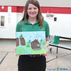 JUNIOR BETA TALENT—Oran Guardian Angel student Courtney Dirnberger holds the painting she created for the Missouri Junior Beta Convention held March 8 and 9 in Poplar Bluff. (<i>The Mirror</i>)