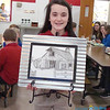 JUNIOR BETA TALENT—Oran Guardian Angel student Taylor Hobbs displays her charcoal sketch of a barn that she entered in the Missouri Junior Beta Convention held March 8 and 9 in Poplar Bluff. (<i>The Mirror</i>)