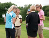 The 10:10 tee time group receives instructions before teeing off on round one from Junior Director Nancy Sebastian.
