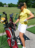 Jacque Bardgett checks her clubs on the range the first day