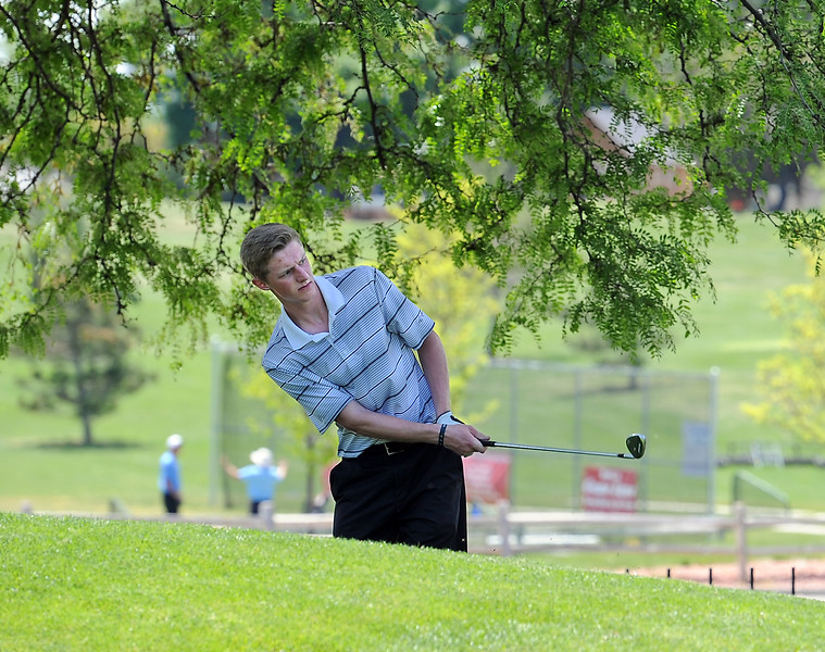 Mitchell Leach chips his ball on to the green Monday, June 6, 2016, during the 2016 Junior Golf Tournament at the Olde Course in Loveland. (Photo by Jenny Sparks/Loveland Reporter-Herald)